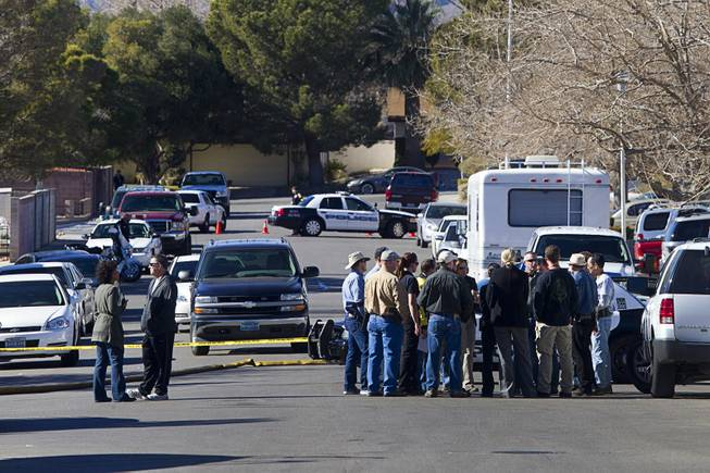 Law enforcement officials confer during a shooting investigation in Boulder City, Jan. 21, 2013.