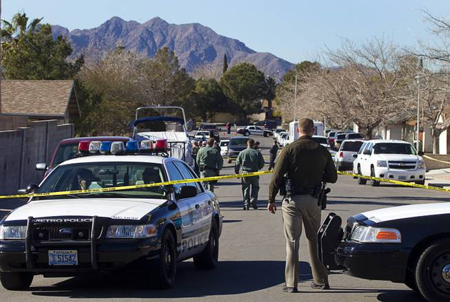 Law enforcement officials investigate a shooting in Boulder City, Jan. 21, 2013.