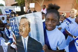 Shania Washington, a fourth grader at Kelly Elementary School, holds a portrait of Martin Luther King Jr. during the 31st annual MLK JR. parade in downtown Las Vegas, Monday, Jan. 21, 2013. MGM Resorts International was the presenting sponsor for the event.