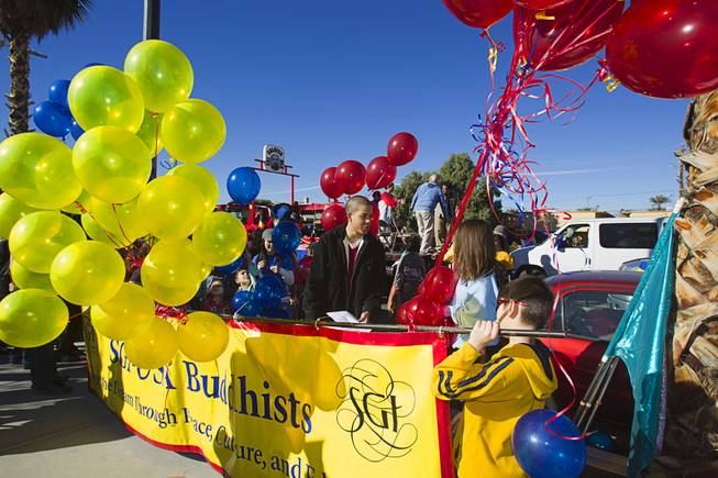 Members of the Soka Gakkai International (SGI) buddhist group prepare for the start of the 31st annual Martin Luther King Jr. parade in downtown Las Vegas, Monday, Jan. 21, 2013. MGM Resorts International was the presenting sponsor for the event.
