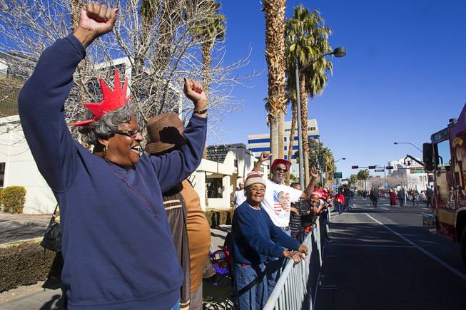 Spectator Pat Brooks, left, cheers during the 31st annual Martin Luther King Jr. parade in downtown Las Vegas, Monday, Jan. 21, 2013. MGM Resorts International was the presenting sponsor for the event.