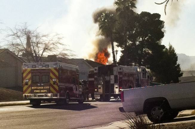 Boulder City fire fighters respond to a house fire in the early afternoon of Monday, Jan. 21, 2013.