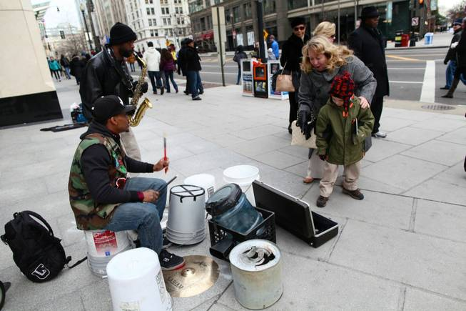 Saxophonist Tim Turner and drummer Markiee Wright play for passers-by at the corner of 13th Street and New York Avenue in Northwest Washington D.C. Monday morning, Jan. 21, 2013.
