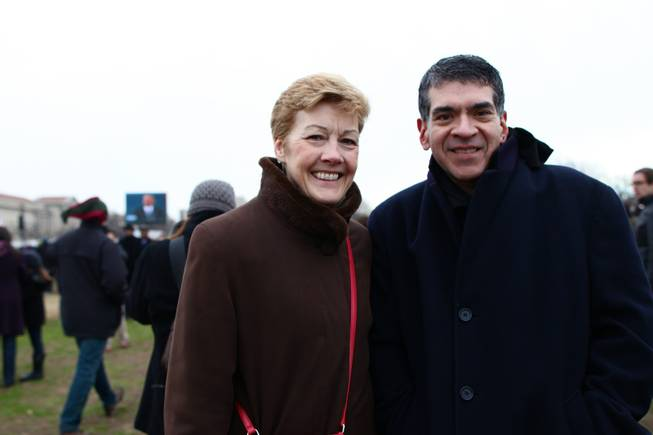 Jane Irwin and Bob Romo of Chicago on the National Mall, with a projection screen of President Barack Obama in the background, on Inauguration Day, Monday, Jan. 21, 2013.