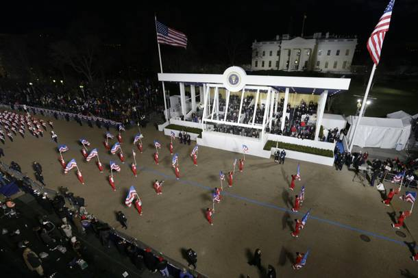 Boston Crusaders Drum & Bugle Corps, Massachusetts perform while passing the presidential box and the White House during the Inaugural parade , Monday, Jan. 21, 2013, in Washington. Thousands  marched during the 57th Presidential Inauguration parade after the ceremonial swearing-in of President Barack Obama.
