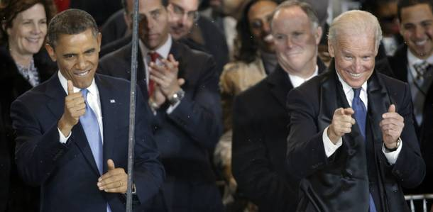 President Barack Obama and Vice President Joe Biden react during the inaugural parade on Pennsylvania Avenue near the White House, Monday, Jan. 21, 2013, in Washington. Thousands  marched during the 57th Presidential Inauguration parade after the ceremonial swearing-in of President Barack Obama.