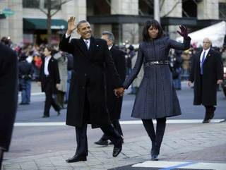 President Barack Obama and first lady Michelle Obama walk down Pennsylvania Avenue during the 57th Presidential Inauguration parade Monday, Jan. 21, 2013, in Washington.