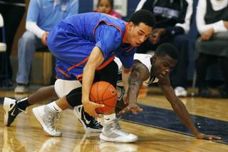 Bishop Gorman's Trey Kennedy, left, and Centennial's Marcus Allen chase a loose ball during their game Tuesday, Jan 22, 2013 at Centennial. Bishop Gorman won 79-71.