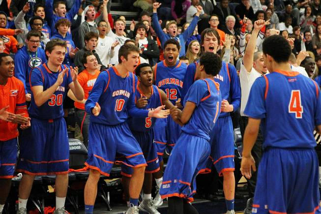 The Bishop Gorman bench celebrates as they pull ahead of Centennial during their game Tuesday, Jan 22, 2013 at Centennial. Bishop Gorman won 79-71.