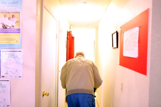 A resident walks down the hall at Sweet Home Belmont, an assisted living facility for seniors in Henderson on Tuesday, January 22, 2013.