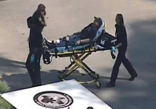 In this frame grab provided by KPRC Houston, an unidentified person is transported by emergency personnel at Lone Star College Tuesday, Jan. 22, 2013, in Houston, where law enforcement officials say the community college is on lockdown amid reports of a shooter on campus.