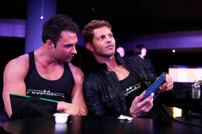 Chippendales cast members James Davis and Jaymes Vaughan watch auditions for the Chippendales World Tour at the Chippendales Theater inside The Rio in Las Vegas on Wednesday, Jan. 23, 2013.
