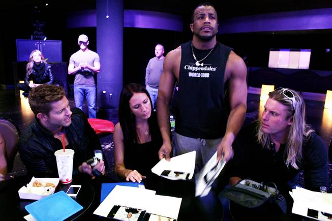 Chippendales cast member Jaymes Vaughan, from left, production tour manager Allie Hahn, world tour dance captain Bryan Cheatham and world tour manager Kevin Cornell evaluate hopefuls during auditions for the Chippendales World Tour at the Chippendales Theater inside The Rio in Las Vegas on Wednesday, Jan. 23, 2013.
