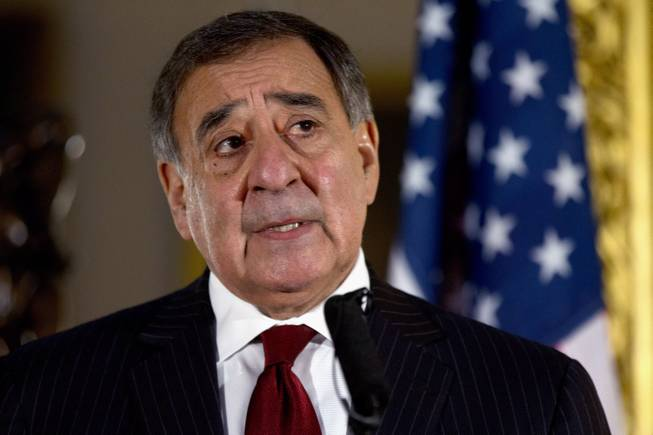 This Jan. 19, 2013, file photo shows Defense Secretary Leon Panetta speaking during a news conference in London. Panetta has removed US military ban on women in combat, opening thousands of front line positions.
