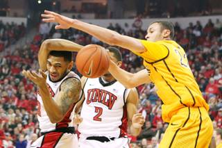 UNLV guard Anthony Marshall is fouled by Wyoming forward Larry Nance while contesting a rebound during their game Thursday, Jan. 24, 2013 at the Thomas & Mack Center.