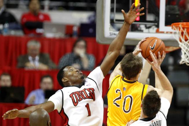 UNLV forward Quintrell Thomas defends a shot by Wyoming guard Nathan Sobey during their game Thursday, Jan. 24, 2013 at the Thomas & Mack Center. UNLV won 62-50.