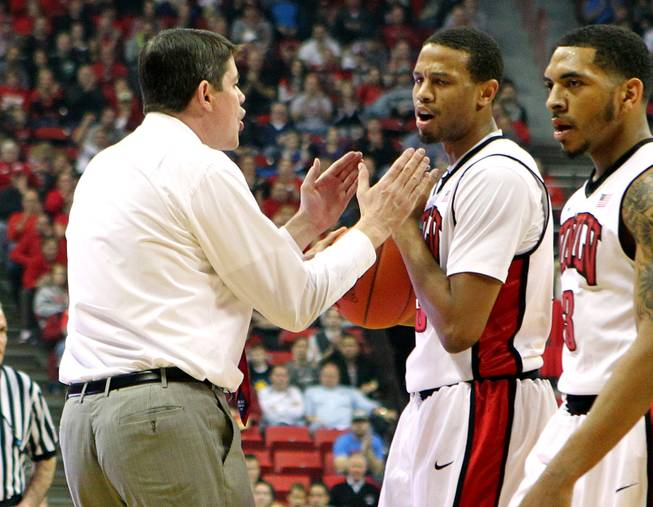 UNLV head coach Dave Rice yells at guard Bryce Dejean-Jones after an ill-advised shot attempt against Wyoming  Thursday, Jan. 24, 2013 at the Thomas & Mack Center. UNLV won 62-50.
