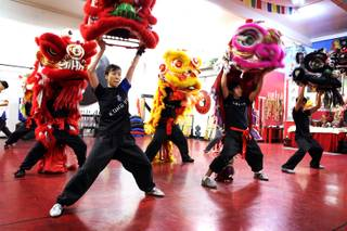 Students Yuko Brazil, from left, and Michael Buenavista practice the lion dance for Chinese New Year at Lohan School of Shaolin in Las Vegas on Thursday, January 24, 2013.