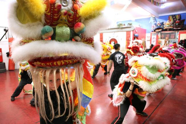Student Natasha Venola, far left, 11, practices the lion dance for Chinese New Year at Lohan School of Shaolin in Las Vegas on Thursday, January 24, 2013.