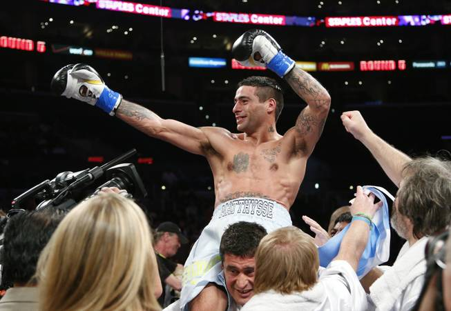 Lucas Matthysse, top, of Argentina, celebrates his TKO victory against Humberto Soto, of Mexico, after a WBC lightweight boxing match in Los Angeles, Saturday, June 23, 2012. Matthysse won by TKO in the fifth round.