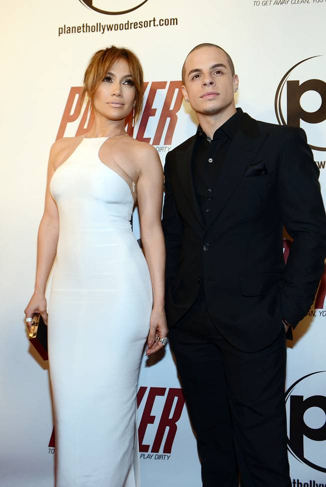 "Jennifer Lopez and Casper Smart arrive at the premiere of her film ""Parker"" at Planet Hollywood on Thursday, Jan. 24, 2013."