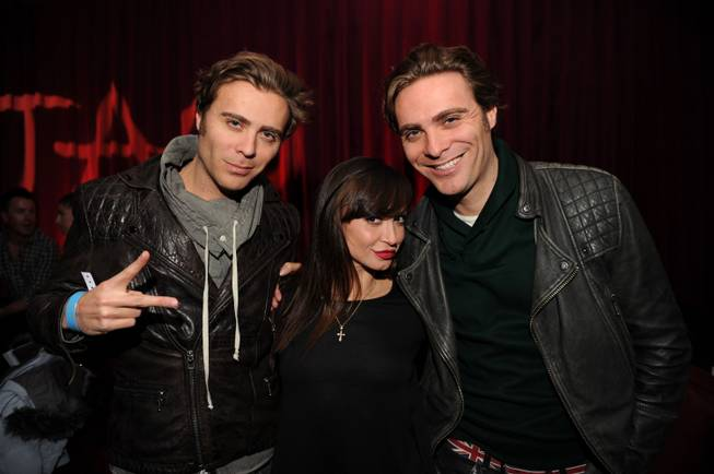The EC Twins flank Karina Smirnoff at the 2013 Sundance Film Festival in Park City, Utah.