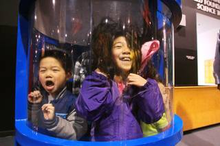 Ethan Kwok screams while his sister Grace Kwok giggles in a hurricane simulator at Lied Discovery Children's Museum Saturday, Jan. 26, 2013.