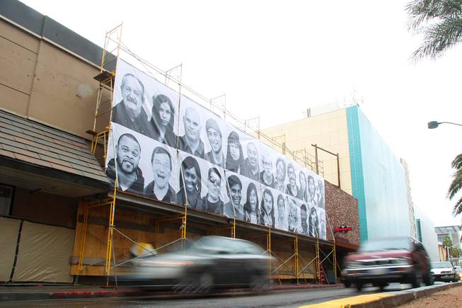 While a space that formerly housed a 7-Eleven store on the corner of Fremont St. and the Strip undergoes renovations, a mural of photos hangs on the scaffolding Saturday, Jan. 26, 2013.