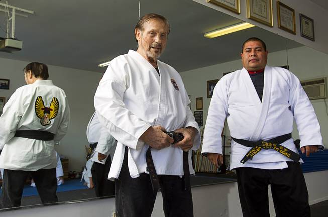Karate master Dan Sawyer poses with instructor Mauro Felix, a fifth degree black belt, during a class at his home Sunday, Jan. 27, 2013. Sawyer teaches in a garage behind his home that has been converted into a karate dojo.