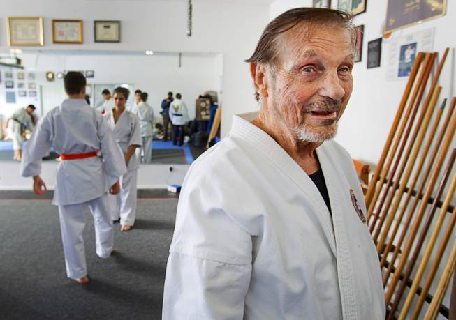 Karate master Dan Sawyer poses during a class at his home Sunday, Jan. 27, 2013. Sawyer teaches in a garage behind his home that has been converted into a karate dojo.