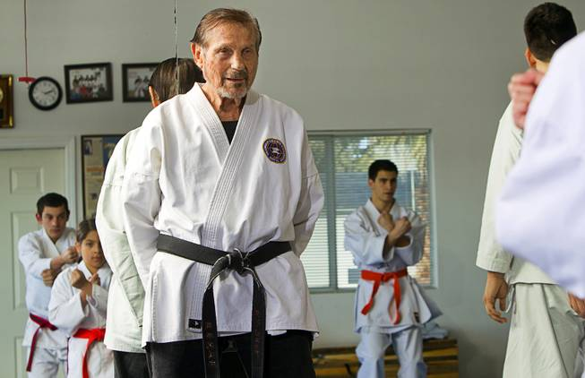 Karate master Dan Sawyer watches over a class at his home Sunday, Jan. 27, 2013. Sawyer teaches in a garage behind his home that has been converted into a karate dojo.