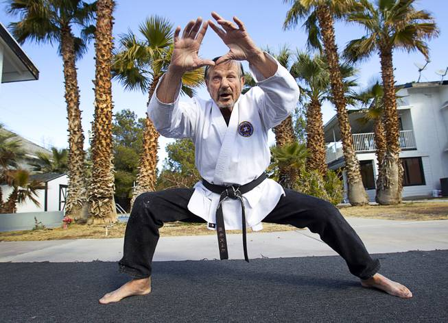 Karate master Dan Sawyer demonstrates his form at his home Sunday, Jan. 27, 2013. Sawyer teaches in a garage behind his home that has been converted into a karate dojo.