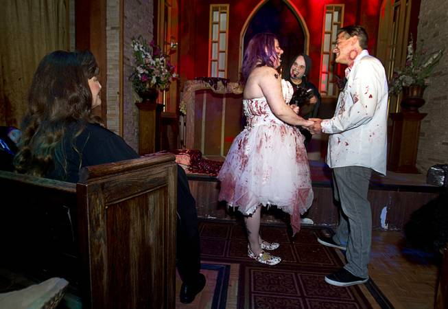 Rosie Grasso and Anthony Gallegos of Las Vegas exchange vows as they get married in the chapel at Eli Roths Goretorium Sunday, Jan. 27, 2013.