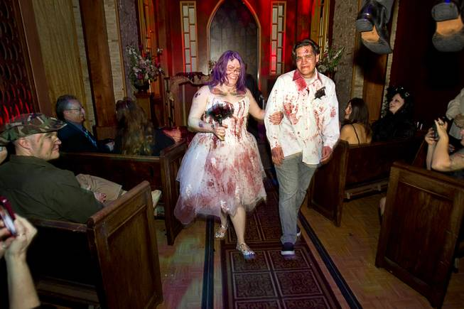 Rosie Grasso and Anthony Gallegos of Las Vegas leave the chapel after getting married in Eli Roths Goretorium Sunday, Jan. 27, 2013.