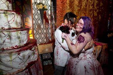 Anthony Gallegos and Rosie Grasso of Las Vegas pose for photos in a wedding reception area after getting married at Eli Roth's Goretorium on Sunday, Jan. 27, 2013.