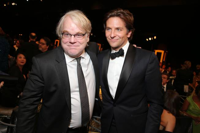 Actors Philip Seymour Hoffman and Bradley Cooper at the 19th Annual Screen Actors Guild Awards at the Shrine Auditorium on Sunday, Jan. 27, 2013, in Los Angeles.