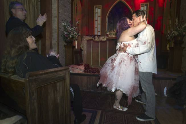 Rosie Grasso and Anthony Gallegos of Las Vegas kiss after getting married in Eli Roths Goretorium Sunday, Jan. 27, 2013. STEVE MARCUS