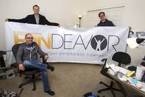 Company co-founders Tom Ellinson, left, and Dean Curtis pose with content manager Darren Flores, seated, at the Fandeavor offices in the Ogden in downtown Las ...