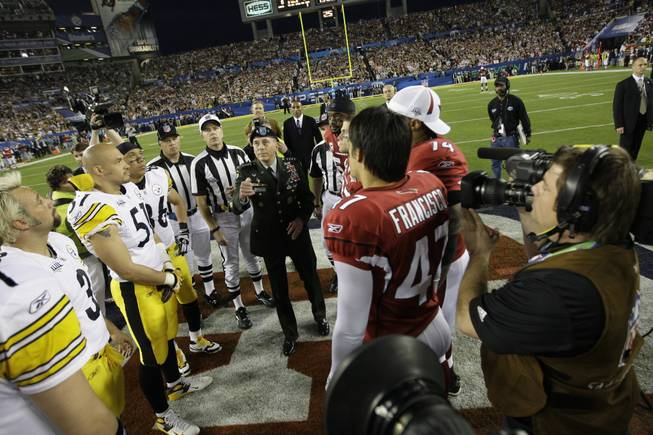 The coin toss prior to the NFL Super Bowl XLIII football game between the Pittsburgh Steelers and Arizona Cardinals, Sunday, Feb. 1, 2009, in Tampa, Fla.