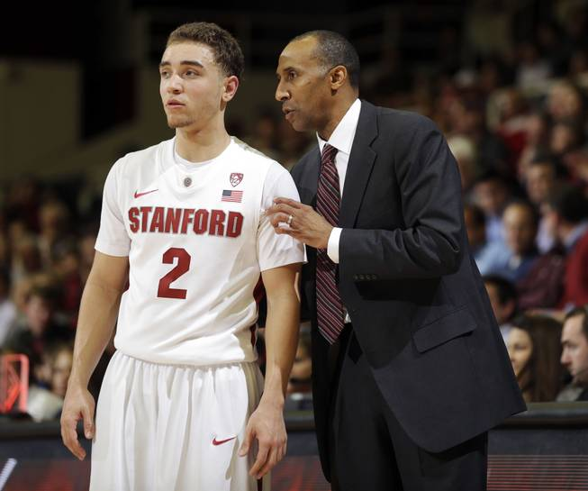 Stanford's Aaron Bright (2) gets instruction from head coach Johnny Dawkins during the second half of an NCAA college basketball game against Washington State in Stanford, Calif., Wednesday, Jan. 9, 2013. Stanford's Pac-12 Conference game Sunday against Oregon State is featured in a prop Super Bowl bet at the LVH.