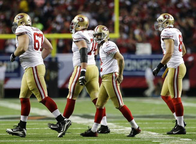 San Francisco 49ers kicker David Akers, second right, walks off the field after missing a field goal during the second half of the NFL football NFC Championship game against the Atlanta Falcons Sunday, Jan. 20, 2013, in Atlanta.