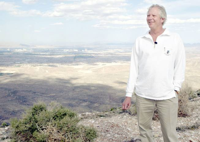 Developer Jim Rhodes smiles on Blue Diamond Hill Monday, May 5, 2003. Las Vegas can be seen in the background. Rhodes plans to develop the property, the site of the Jim Hardie Gypsum Mine,  into a residential community, he said.