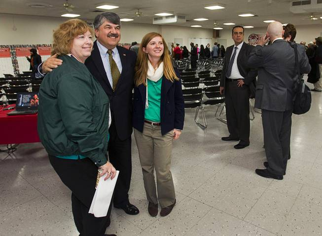 AFL-CIO President Richard Trumka, center, poses for a photo following a gathering of union leaders, working families and community partners at the Culinary Workers Local 226 union hall Tuesday, Jan. 29, 2013.