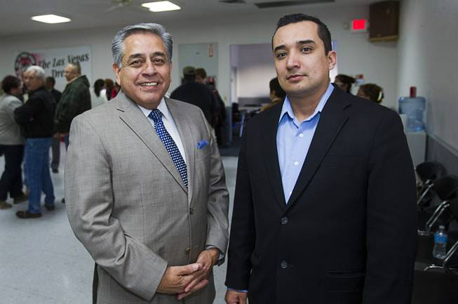 Fernando Romero, left, president of Hispanics in Politics, and Eddie Ramirez, representing the Laborers-Employers Cooperation and Education Trust (LECET), pose following a gathering of union leaders, working families and community partners at the Culinary Workers Local 226 union hall Tuesday, Jan. 29, 2013.