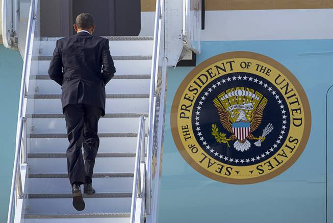 President Barack Obama boards Air Force One at McCarran International Airport after to kicking off his public push for immigration reform in Las Vegas, Nevada Tuesday, Jan. 29, 2013.