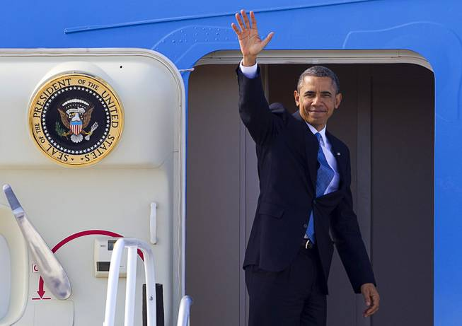 President Barack Obama waves from Air Force One at McCarran International Airport after to kicking off his public push for immigration reform in Las Vegas, Nevada Tuesday, Jan. 29, 2013.