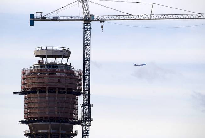Air Force One flies past the Federal Aviation Administration (FAA) control tower under construction at McCarran International Airport after President Barack Obama kicked off his public push for immigration reform in Las Vegas, Nevada Tuesday, Jan. 29, 2013.
