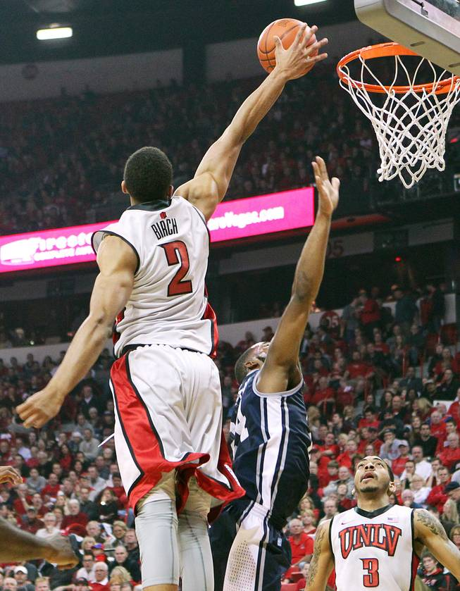 UNLV forward Khem Birch blocks UNR guard Deonte Burton's shot during their game Tuesday, Jan. 29, 2013.