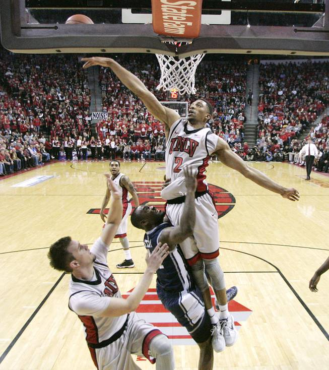 UNLV forward Khem Birch swats away UNR guard Malik Story's shot during their game Tuesday, Jan. 29, 2013 at the Thomas & Mack. UNLV won the game 66-54.