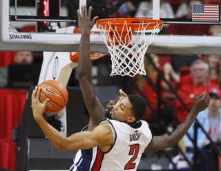 UNLV forward Khem Birch grabs a rebound from UNR guard Jerry Evans Jr. during their game Tuesday, Jan. 29, 2013 at the Thomas & Mack. UNLV won the game 66-54.